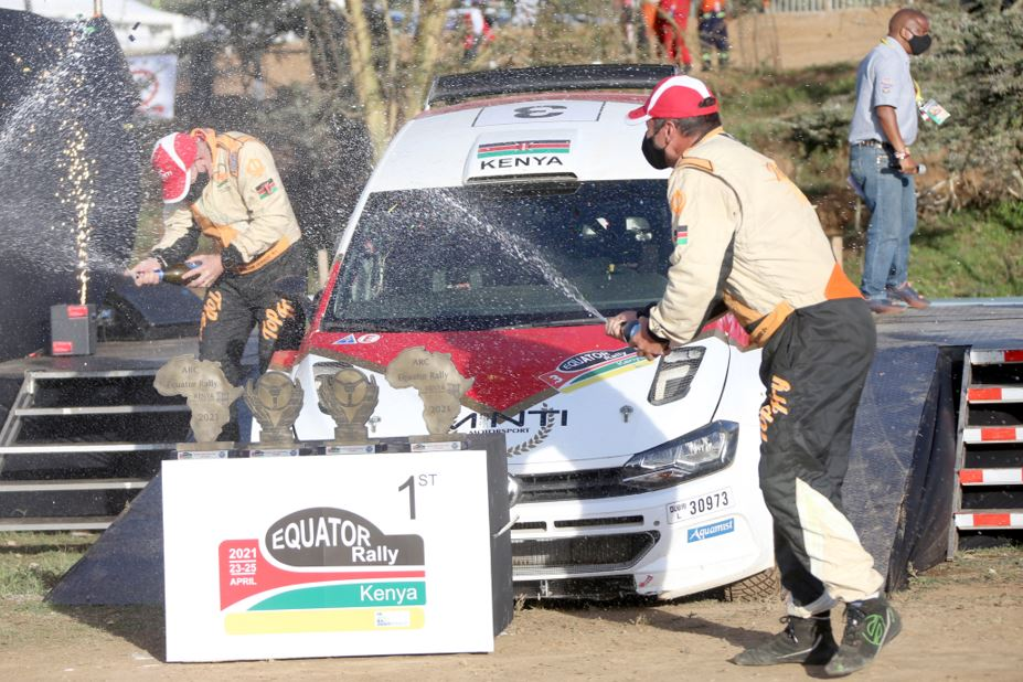 Carl Tundo (right) and navigator Tim Jessop celebrate at the Kenya Wildlife Service Training Institute Service Park finish ramp in Naivasha after winning the African Rally Championship Equator Rally