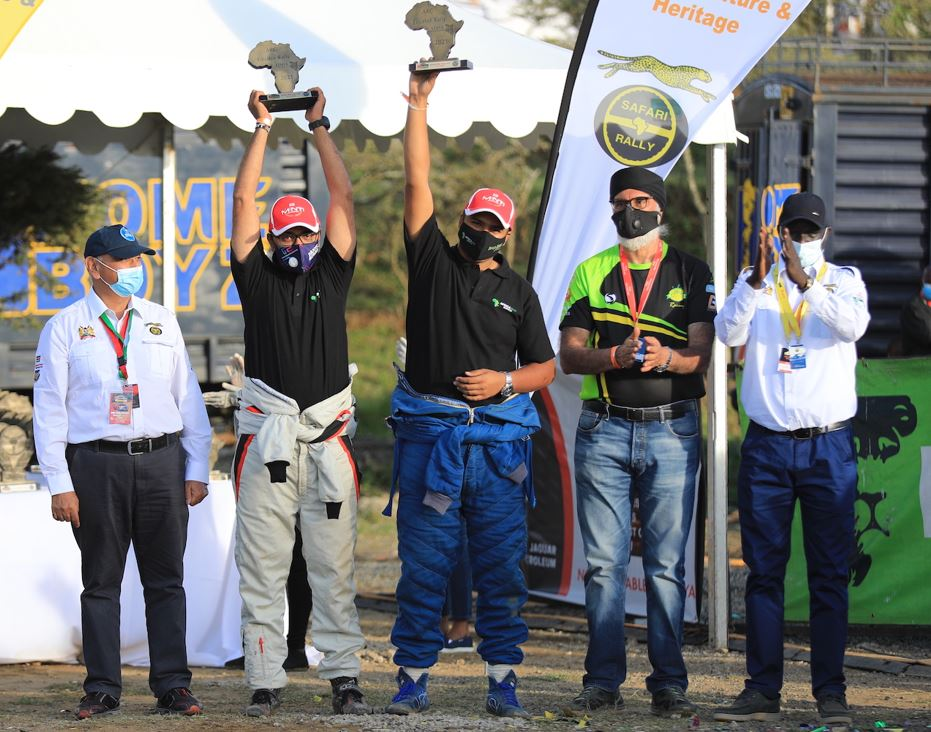 Hamza Anwar (second left) with his navigator Riaz Ismail with their trophies at the finish ramp of the Equator Rally in Naivasha on Sunday (April 25). The officials are (from left) Surinder Thatthi, Jas Rai and Sports Chief Administrative Secretary Simon Kachapin. Anwar, 22, was the youngest driver in the rally and finished fifth overall. PHOTO/ANWAR SIDI/ NATION