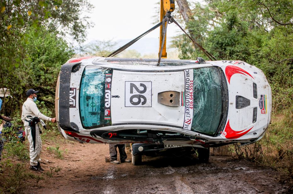 Hussein Malik, who was co-driven by Linet Ayuko, looks on as his Mitsubishi Evolution 10 is recovered after landing in a ditch at Soysambu on the opening day of the ARC Equator Rally on Saturday (April 24, 2021). POOL/ NATION