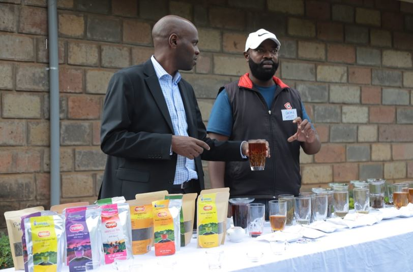 KTB-Company-Secretary-Allan-Njoroge-samples-tea-varieties-offered-at-Gatura-Greens-Tea-Farm-during-the-launch-of-Farm-tours-in-Muranga-county-with-him-is-Gat